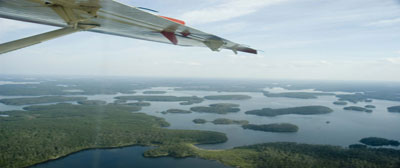 Float Plane Flying Over Northern Ontario Lakes